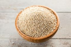Raw quinoa seeds in a bowl stock image