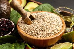 Raw quinoa seeds in a bowl stock images
