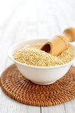 Raw quinoa seeds. In the bowl on wooden background closeup Royalty Free Stock Photos
