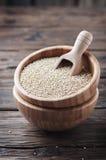 Raw quinoa on the vintage table Stock Photo