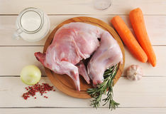 Raw rabbit on a wooden Board with ingredients for stewing milk, Royalty Free Stock Photography