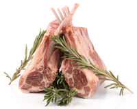 Raw rack of lamb with rosemary,  on white Royalty Free Stock Images