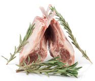 Raw rack of lamb with rosemary,  on white Royalty Free Stock Image