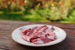 Raw rack of lamb on vintage plate Royalty Free Stock Image