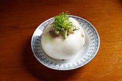 Raw radish. Raw white radish   in round  plate on wood Royalty Free Stock Photo
