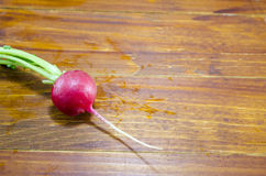 Raw radish on a wooden table. Fresh and moist radish on a wooden table Stock Photography