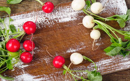 Raw radishes on a wooden board. Top view Stock Photography