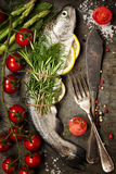 Raw rainbow trout with lemon, herbs and spice. On rustic background Royalty Free Stock Photo