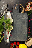 Raw rainbow trout with lemon, herbs and spice. On rustic background Stock Image