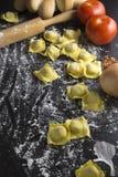 Raw ravioli on black background Stock Images