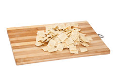 Raw ravioli with meat on the wooden board.  Stock Photography