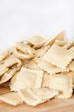 Raw ravioli with meat on the wooden board Royalty Free Stock Image