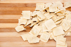 Raw ravioli with meat on the wooden board.  Royalty Free Stock Photography