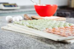 Raw Ravioli Pasta Arranged On Cutting Board Stock Images