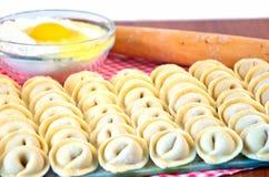 Raw ravioli in a row Stock Photo