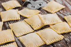 Raw ravioli on wooden background Royalty Free Stock Images