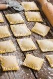 Raw ravioli on wooden background Stock Photo