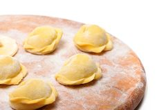 Raw ravioli on wooden cutting board Royalty Free Stock Photo