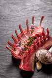 Raw Rectangle of Lamb with Herbs and Garlic Royalty Free Stock Image