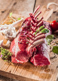 Raw Rectangle Rack of Lamb Chops on Wooden Board Stock Photography