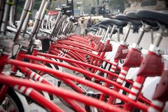 Raw of red bycicle on street Stock Photos