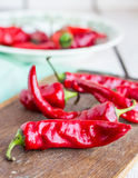 Raw red chili pepper on a cutting board, spices. On a wooden board Stock Photography