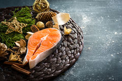 Raw red fish. With Christmas decorations Royalty Free Stock Image