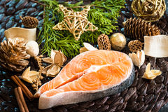 Raw red fish. With Christmas decorations Stock Image