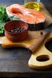 Raw Red Fish on a cutting board Stock Photo