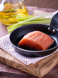 Raw red fish fillet. On frying pan, close up, selective focus Royalty Free Stock Photo