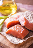 Raw red fish fillet. With sea salt over wooden board, selective focus Royalty Free Stock Photo