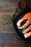 Raw Red Fish on a grill pan Royalty Free Stock Photography