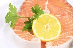 Raw red fish and lemon  backgrounde. On white Royalty Free Stock Image
