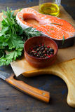Raw Red Fish, parsley, rosemary and spice on a cutting board Stock Image