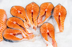 Raw red fish is sliced, ready for sale. In a supermarket stock photography