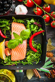 Raw red fish. With vegetables Stock Photos