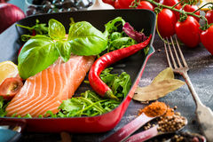Raw red fish. With vegetables Royalty Free Stock Photos