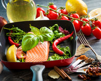 Raw red fish. With vegetables Stock Images