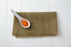 Red lentils in spoon Royalty Free Stock Photos