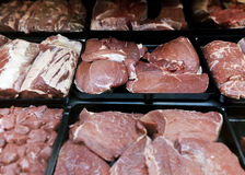 Raw red meat at butcher's counter Stock Image