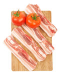Raw red meat fat bacon and tomato on a wooden board isolation on. White Royalty Free Stock Photos