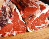Raw Red Meats. Close-up view of Raw Red Meats on a table stock image