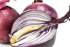 Raw red onions. Closeup of some raw red onions on a white background Stock Photo