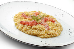 Raw red prawns on risotto Carnaroli. Fish Dish Raw red prawns on risotto Carnaroli Royalty Free Stock Image