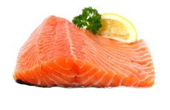 Raw, red salmon fillet with lemon wedge Royalty Free Stock Photo
