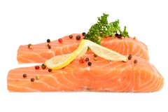 Raw salmon filet with spicy isolated on white. Raw red salmon part of filet with spicy isolated on white Royalty Free Stock Images
