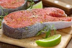 Raw red salmon steaks Stock Photos