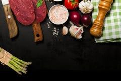Raw rib eye beef steak cooking with ingredients royalty free stock image