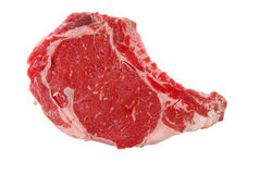 Raw rib eye steak. A juicy prime rib eye steak isolated on a white background royalty free stock photos