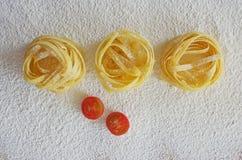 Raw ribbon pasta Stock Image